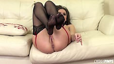 She shows off her hot ass and sucks her dildo before using it