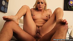 The attractive milf slides that dick in her peach riding it with desire and passion