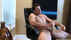 Ripped Danny beats his hard cock, moaning has he nears orgasm