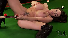 Huge tit, tattooed brunette toys herself with a pool cue on the table
