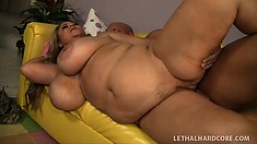The stacked milf gives him a great blowjob and gets spoon fucked hard on the couch