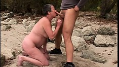 By the lake, a horny mature lady sucks a big dick before getting pounded doggy style