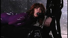 Mistress and slave in latex outfits with the slave getting toy fucked