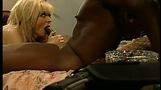 Naughty blonde cougar with big boobs reveals how much she loves that huge black cock