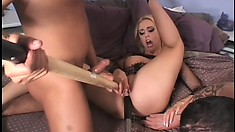Kinky blonde bitch gets her holes stuffed to the limit in a threesome