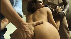 Provocative brunette with a spicy ass gets nailed hard by two hung guys